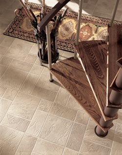 luxury vinyl flooring at the bottom of a staircase